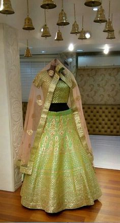 Light Parrot Green Lehenga | WedMeGood Brocade Parrot Green Blouse with Parrot Green Lehenga and Gota Patti Work, Peach Net Lehenga with Light Green Brocade Border | Find more lehenga designs on wedmegood.com #wedmegood #lehenga #green #peach