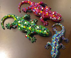 Mosaic design style lizards, in multiple colors, shapes and sizes. Available at Memento Gift Shop, Palm Springs 760-325-1963