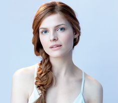 6 Easy Braided Hair Looks for hot summer days.  This Model is wearing a side fishtail braid hairstyle.