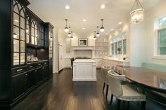 Kitchen 0 wall of windows, open shelving, black and white, leather chairs, hicks pendants