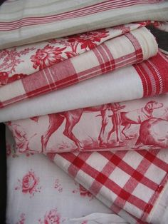 red and white french linens-these would be lovely paired with aqua or light blue.