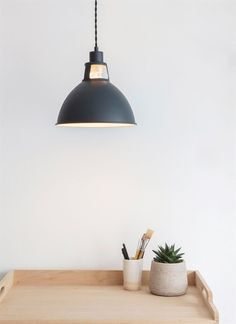 The urban styling of the Digbeth Pendant Light has been finished in our Matt Carbon colourway