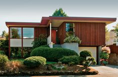 The 1955 Usonian-type house has typical cedar board-and-batten walls.Overhanging eaves reiterate the shadow box formation of the stackedbedroom windows and hall skylight.