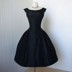 on HOLD vintage 1950s dress ...exquisite dior inspired new look SUZY PERETTE new york black bouffant cocktail dress with jet beads. $340.00, via Etsy.