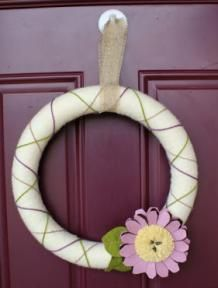 Create a beautifully decorated wreath for your front door with #GlueDots, a foam wreath and yarn! #homedecor