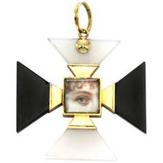 A Multi-Gem Maltese Cross Pendant