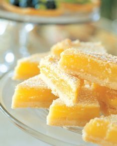 Ina Garten's Lemon Bars  For the crust: 1/2 lb unsalted butter at room temperature 1/2 cup granulated sugar 2 cups all-purpose flour 1/8 tsp kosher salt  For the filling: 6 extra-large eggs at room temperature 3 cups granulated sugar 2 T grated lemon zest (4 to 6 lemons) 1 cup freshly squeezed lemon juice 1 cup all-purpose flour Confectioners' sugar, for dusting  Preheat the oven to 350 degrees.