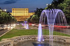 The Palace of Parliament in Bucharest Romania with fountains in the foreground. Air Travel Tips, Travel Tips For Europe, Top Travel Destinations, Us Travel, Bucharest Romania, Popular Photography, Business Travel, Great Places, Travel Inspiration