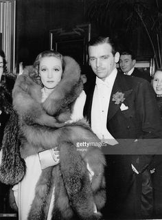Marlene Dietrich and Douglas Fairbanks jr. at their arrival in the Leincester Square Theatre on the occasion of the premiere of their film 'The Garden of Allah'. Photograph. December 17th 1936.