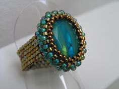 Indicolite Oval Ring. Links to the for profit site ellad2.com selling various patterns.