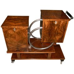 Unique Art Deco Rolling Bar or Liquor Cart | From a unique collection of antique and modern dry bars at https://www.1stdibs.com/furniture/storage-case-pieces/dry-bars/