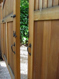Fascinating Wooden Driveway Gate Designs: Traditional Landscape Opened Double Wooden Driveway Gate Swings In Toward The Yard Pull Handle ~ moabc.net Decorating Inspiration