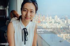 Stock Photo : Korean woman smiles at camera