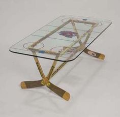hockey stick table I love this! Except I would frost the glass for some white.