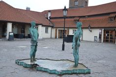A Piss Sculpture by David Cerny in front of the Franz Kafka museum. Two men are standing on opposite ends, and they appear to be peeing onto the country. Prague, Czech Republic