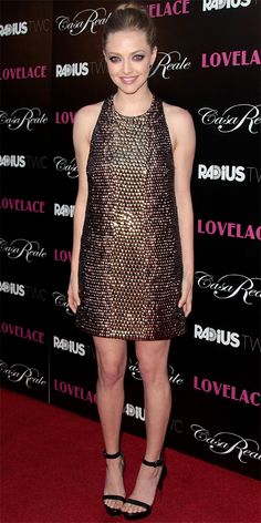 08/06/13: At the Los Angeles premiere of Lovelace, Amanda Seyfried stunned in a bronze one-of-a-kind embroidered racerback Gucci dress with a snakeskin effect, pairing it with black Givenchy heels.
