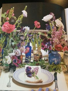 Another from Mum's book - don't so much like the flowers, more the vases and bottles they're in for inspiration.
