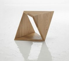 Autori Vari have created this beautiful unique-shaped coffee table. This 43cm high oak-treated geometric shape also acts as a base for a glass pane to create a bigger table.