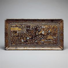 Rectangular Tray with Scene from the Tale of Genji  Period: Edo period (1615–1868) Date: early 17th century Culture: Japan Medium: Gold maki-e on black lacquer, inlaid with mother-of-pearl Dimensions: W.16 in. (40.6 cm); L. 30 in. (76.2 cm) Classification: Lacquer