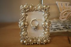 love the idea of having this cute framed ring holder on my bedside table or bathroom sink. I would totally use this to hold my ring while I wash my face, apply lotion and for storing my ring overnight. With just a couple of quick DIY steps, you can change any ordinary picture frame into your own clever ring frame. Too cute!