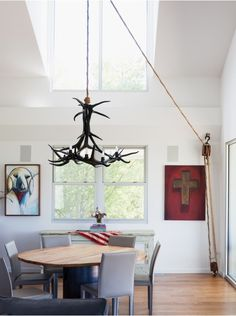 Really like the chandelier-on-a-pulley.  (Remodelista)