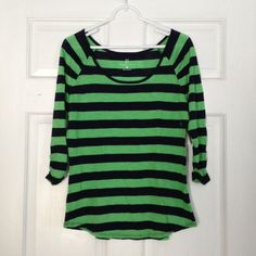 NWT Navy and Green Striped 3/4 Sleeve Tee NY&Co New with tags. Navy blue and green stripe 3/4 sleeve tee from New York & Company. Size small. Ruching on sleeves. Scoop neckline and hem. 60% cotton; 40% modal. Machine wash gentle cycle. Tumble dry low. (Listed 2/14/16 BOX15). New York & Company Tops
