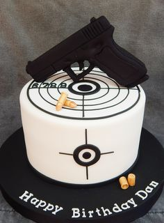 "Gun is styro foam covered in fondant, 7"" vanilla cake..."
