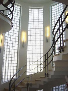 Staircase & Wall Sconces - Art Deco styling plus the floor to ceiling glass blocks for natural light but complete privacy...a big fan of glass blocks.