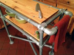 Interclamp galvanised pipe fittings used to make a DIY kitchen bench. Shop our Hammersmith range online.