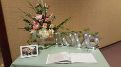 Sign in table for reception sage green overlay