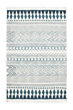 <ul> <li> Zig-zag and striped print rug</li> <li> Tassels at both ends</li> </ul>  Products may vary slightly from one example to the next due to the handmade nature of the products. Please also note that the rug will come folded and may have fold creases which will disappear over time.