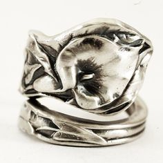 Beautiful Calla Lily sterling silver spoon ring that is very unique! Done in classic Art Nouveau style, the carving is very deep high relief for a 3-D sculpture-like feel. Calla Lilies often symbolize magnificent beauty. They are native to South Africa, and thrive in the steady climate of Madagascar. Made of and stamped Sterling Silver, I put a brushed finish on these rings to even out the surface for a brilliant satin finish! Simply stunning with the patina weve added to help the design…