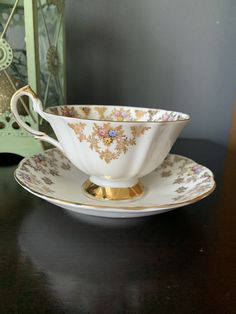 Gorgeous Vintage Queen Anne Teacup and Saucer, Wide Mouth Teacup, stunning Pink, Blue and Yellow Tiny Flowers, Heavy Gold Footed Cup