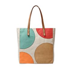 Nothing is more stylish than a classic polka-dot pattern. Zoey tote embodies this playful trend with bold colors and a versatile canvas.
