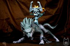 This is Wolf Link and Midna paper craft for kids from The Legend of Zelda : Twilight Princess . Midna is a Twili who became Link's companion during his adventure to battle the great evil. She is cynical and has a playful character. Her hometown is the Palace of Twilight in the Twilight Realms. Like a vampire she can't stand light and hides behind Link's shadow when they venture in the Light Realms. Since templates comes with two models the files is quite large. Otaku crafts made...