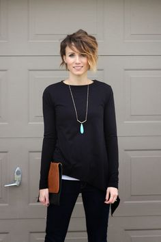 Short choppy asymmetrical hair cut. Asymetrical tee, dark denim and leopard ankle boots