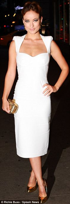 White hot: Olivia Wilde slipped into a figure-hugging white dress and metallic accessories for the premiere of her new film Butter at the start of the evening