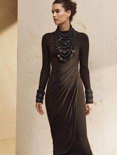- Description - Details - Customer Care Luxurious simplicity takes a surprise turn by way of a long sleeve dress with v-neck open back. All the while, draped jersey twists and flatters along the front