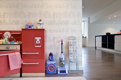 Super cute play kitchen near the adult kitchen in Sussex residence.