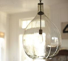 love the natural look of this piece.  Glass pendant light.