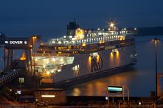 Night view of the MS Spirit of Britain Ferry, Eastern Docks, Dover Harbour, Kent, England, UK. Ship berthed at Ferry Terminal 6 (FT6) January 20th 2011, eve of starting service on the Dover to Calais cross-English Channel route. P and O Ferries vessel: Call Sign 2DXD4, IMO 9524231, MMSI 235082716. Sister to Spirit of France. View from Victorian Coastguard Cottages, Broadlees Bottom, White Cliffs of Dover. A Port of Dover Tourism and Travel photo. See: http://www.panoramio.com/photo/46855244