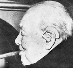 Figure 1. England's Sir Winston Churchill has added a new trademark to his famed stogie, a light-weight, over-the-ear hearing aid.