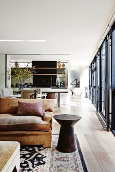 14 of the most beautiful living rooms on vogueliving.com.au: The living area of Robin Boyd's renowned 'Bridge House' in Toorak, Melbourne — renovated by architect Steven Jolson nearly 60 years after it was built — is furnished with a low-key but luxe informality.