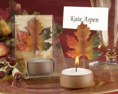 Place card holders, think this idea would be cooler if it was on the leaves-- idea by CJ
