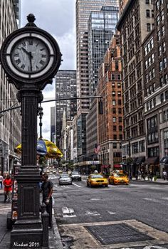 The sidewalk clock at 522 Fifth Avenue & W 44th St, was built in 1907 by Seth Thomas, a clock company founded in 1813. They also made Grand Central's clock.