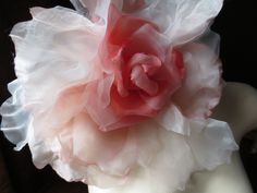 Grand silk rose in coral color:  https://www.etsy.com/listing/169910782/grand-millinery-rose-in-peach-coral?