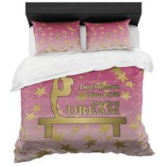 Gymnastics Live your Dream Duvet Bed in a Box in Berry Gradient and Gold Stars Set includes 2 Pillow Shams.  Duvet Cover- King or Queen • Soft to the touch microfiber fabric • Concealed zipper closure at the bottom • Internal ties in all four corners for perfect duvet placement • Hand sewn finishes • Printed top with