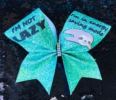 Excited to share this item from my shop: Sloth Energy Saving Mode Cheer Bow I'm not lazy, I'm in energy saving mode sloth. Glitter Vinyl Cheer Bow with sloth embellishment, two pony tail bands. Cute Cheer Bows, Cheer Hair Bows, Girl Hair Bows, Cheerleading Jumps, Cheer Stunts, Cheerleading Uniforms, Cheer Pictures, Cheer Pics, Softball Pictures