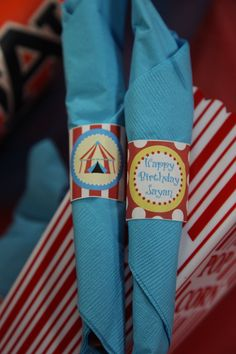 Vintage Circus Birthday Party by Abbie Pari - napkin rings made by my husband. We just cut out and taped them around the silverware.