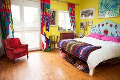 Caro & Josh's Colorful & Quirky English Home I love the color of those walls !!